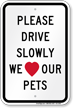 Drive Slowly We Love Our Pets Sign