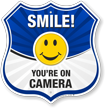 Smile You are On Camera Shield Sign